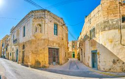 The medieval street in Naxxar, Malta. The medieval corner house with wall sculpture of Saint Paul in old residential neighborhood of Naxxar town, Malta royalty free stock images