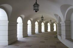 Medieval corridor. With arches and lanterns Stock Photos