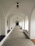 Medieval corridor in the cloister Stock Images