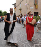 Medieval costume party in Italy. Man and woman in the village Scheggia in Umbria. It is a historical festival in which is corso delle Bighe to see Royalty Free Stock Photography