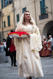 Medieval costume party. Taggia, Italy - February 26, 2017: Participant of medieval costume party in the historic city of Taggia in Liguria region of Italy. The royalty free stock images