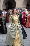 Medieval costume party. Taggia, Italy - February 26, 2017: Participant of medieval costume party in the historic city of Taggia in Liguria region of Italy. The stock images
