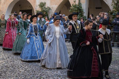 Medieval costume party. Taggia, Italy - February 26, 2017: Participants of medieval costume party in the historic city of Taggia in Liguria region of Italy. The stock images