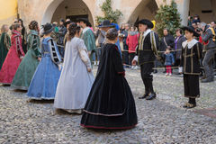 Medieval costume party. Taggia, Italy - February 26, 2017: Participants of medieval costume party in the historic city of Taggia in Liguria region of Italy. The royalty free stock images