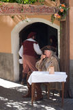 Medieval costume party. Taggia, Italy - February 26, 2017: Participants of medieval costume party in the historic city of Taggia in Liguria region of Italy. The stock photography