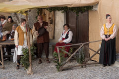 Medieval costume party. Taggia, Italy - February 26, 2017: Participants of medieval costume party in the historic city of Taggia in Liguria region of Italy. The royalty free stock photo