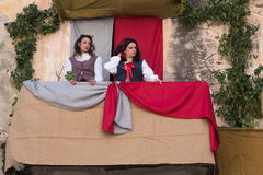 Medieval costume party. Taggia, Italy - February 26, 2017: Participants of medieval costume party in the historic city of Taggia in Liguria region of Italy. The royalty free stock image