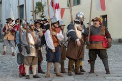 Medieval costume party. Taggia, Italy - March 17, 2018: Participants of medieval costume party in the historic city of Taggia in Liguria region of Italy. The stock photo