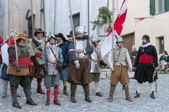 Medieval costume party. Taggia, Italy - March 17, 2018: Participants of medieval costume party in the historic city of Taggia in Liguria region of Italy. The royalty free stock image