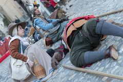 Medieval costume party. Taggia, Italy - March 17, 2018: Participants of medieval costume party in the historic city of Taggia in Liguria region of Italy. The stock image