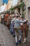 Medieval costume party. Taggia, Italy - March 18, 2018: Participants of medieval costume party in the historic city of Taggia in Liguria region of Italy. The royalty free stock images