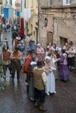 Medieval costume party. Taggia, Italy - March 18, 2018: Participants of medieval costume party in the historic city of Taggia in Liguria region of Italy. The royalty free stock photos