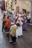 Medieval costume party. Taggia, Italy - March 18, 2018: Participants of medieval costume party in the historic city of Taggia in Liguria region of Italy. The stock image