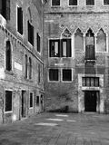 Medieval courtyard in venice with old windows repaired walls a Stock Images