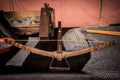 Medieval crossbow made of wood and metal. Medieval crossbow. Display of medieval armament. Medieval tools. Crafts in iron and wood Royalty Free Stock Photos