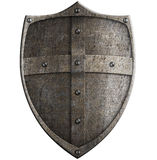 Medieval crusader's metal shield isolated with clipping path. Included Royalty Free Stock Photos