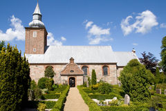 Medieval danish church. And graveyard. old religious building in denmark Stock Photos