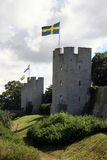 Medieval defence-line. Old wall in medieval style. Swedish flag in tower royalty free stock images