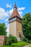 Medieval defense tower of Biertan fortified church, in Transylvania, Romania. Sightseeing tour concept for travelling in Europe. Medieval defense tower of stock image