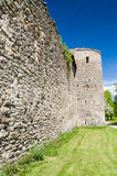 Medieval defensive tower and wall Stock Images