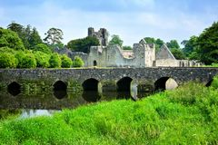 Medieval Desmond Castle, Ireland with stone bridge, Adare, County Limerick royalty free stock photos