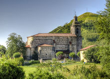 Medieval detached Church in the field. Cantabria, Spain Royalty Free Stock Images
