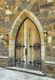 Medieval Door. Medieval architecture with an old wooden arched doorway royalty free stock photos