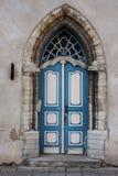 Medieval door. Blue arched wooden medieval door Stock Photography