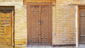 Medieval door. The compilation of medieval carved wooden doors from Uzbek cities of Khiva, Samarkand and Bukhara, decorated with traditional fine islamic stock video footage