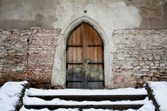 Medieval door with graffiti on it Royalty Free Stock Photo