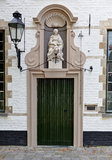 Medieval door and Holy Virgin in the beguinage of Bruges / Brugge, Belgium Royalty Free Stock Images