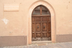 Medieval door in Italy Stock Photography