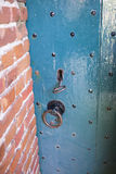 Medieval door with keyhole and key Stock Image