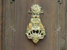 Medieval door knocker. Old metal door knocker on a wooden door in Malta Royalty Free Stock Photo