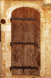 Medieval door in rural stone wall house, Provence Stock Photo