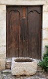 Medieval door in rural stone wall house, Provence Stock Images