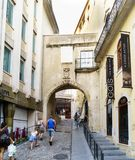 Medieval door on a slope accessing the university in the oldest part of the city. Coimbra, Portugal, August 13, 2018: Medieval door on a slope accessing the stock image