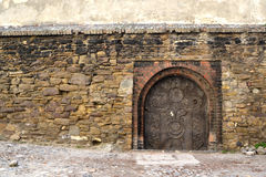 Medieval door. Medieval small door to a secret entrance Stock Photography