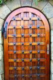 A medieval door under the coast reinforcement wall near Playa De Fanals in Lloret de Mar, Spain. stock image