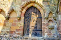 Medieval doors in Bolton Abbey,Great Britain. Bolton Abbey is an estate in Wharfedale in North Yorkshire, England, which takes its name from the ruins of the Royalty Free Stock Image