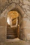 Medieval doorway. Ancient doorway in castle showing a spiral stairway beyond Royalty Free Stock Image