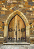 Medieval Doorway. Medieval architecture with an old wooden arched doorway Stock Photos