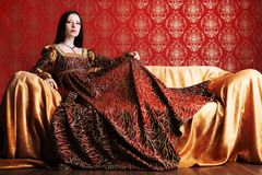 Medieval dress. Portrait of a beautiful woman in medieval era dress. Shot in a studio Royalty Free Stock Photography
