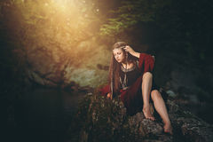 Medieval dressed woman in magical stream Stock Photo