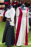 Medieval dresses at a medieval market. Two medieval dresses at a medieval market royalty free stock photo