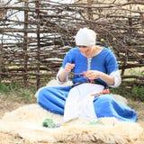 Medieval dressmaker Stock Photography