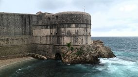 Medieval Dubrovnik Croatia  game of thrones. Dubrovnik Croatia dramatic photograph of medieval castle and the raging blue grey sea. Game of thrones Royalty Free Stock Photography