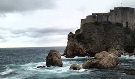 Medieval Dubrovnik Croatia  game of thrones. Dubrovnik Croatia dramatic photograph of medieval castle and the raging blue grey sea. Game of thrones scenes were Royalty Free Stock Photos