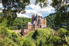Medieval Eltz Castle in Germany. Medieval Eltz Castle nestled in the hills above the Moselle River between Koblenz and Trier, Germany Stock Photos