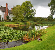 Medieval English Manor and Garden Stock Images